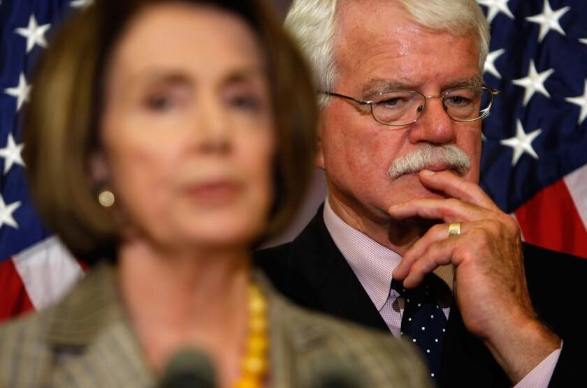 Rep. George Miller, seen behind Rep. Nancy Pelosi on Capitol Hill.