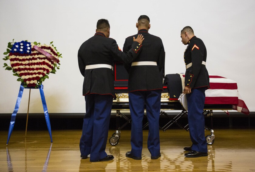 Friends and relatives view the body of Carlos Segovia-Lopez at Bob Hope Patriotic Hall in Los Angeles in October.