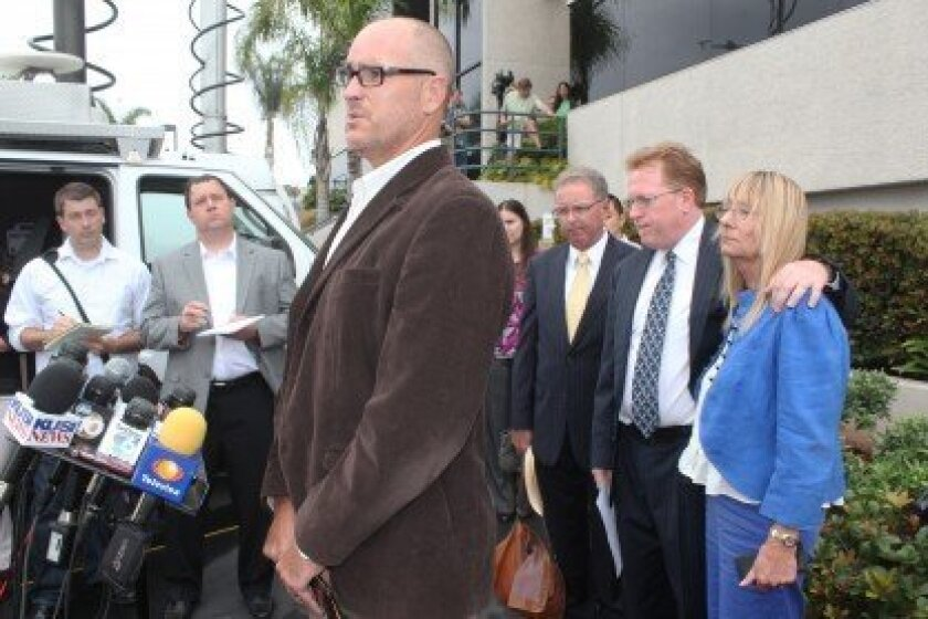 Attorney Marco Gonzalez addresses news media Thursday morning, July 11, outside the offices of Briggs Law Corporation. Behind him are attorney Cory Briggs and former Filner employee Donna Frye. All three submitted letters to the mayor asking for his resignation. Pat Sherman photos