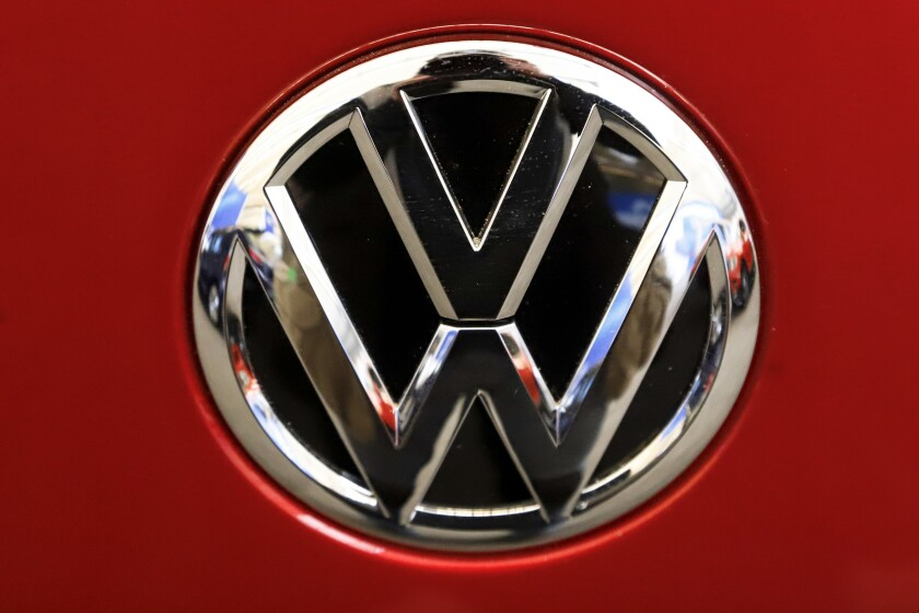 FILE - This Feb. 14, 2019, file photo, shows the Volkswagen logo on an automobile at the 2019 Pittsburgh International Auto Show in Pittsburgh. The U.S. government's road safety agency has opened two investigations into problems with Volkswagen vehicles, including one that alleges serious gasoline leaks under the hood. Details of the probes covering nearly 215,000 vehicles were posted Friday, April 2, 2021, on the National Highway Traffic Safety Administration website. (AP Photo/Gene J. Puskar, File)