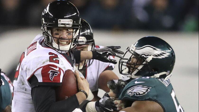 Philadelphia Eagles defensive end Brandon Graham sacks Atlanta Falcons quarterback Matt Ryan during