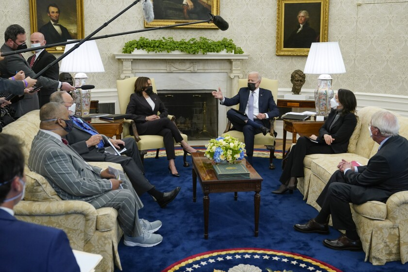 President Joe Biden and Vice President Kamala Harris meet with lawmakers to discuss the American Jobs Plan in the Oval Office of the White House, Monday, April 12, 2021, in Washington. (AP Photo/Patrick Semansky)
