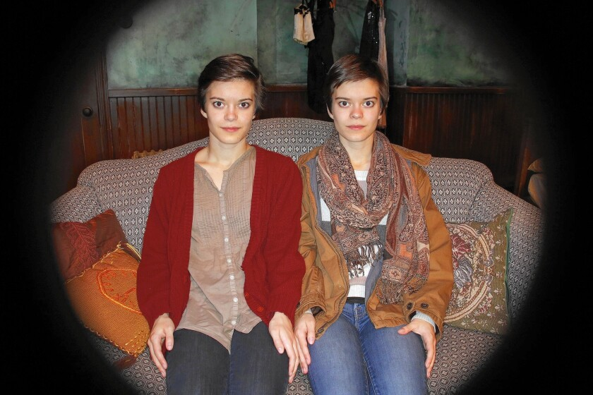 "Emily Hinkler, left, and her identical twin Elizabeth star in ""My Sister,"" set in pre-World War II Berlin. Elizabeth plays Matilde, who has cerebral palsy and writes material for Emily's Magda to perform in a cabaret."