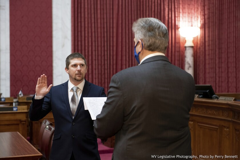 Derrick Evans is given the oath of office in the West Virginia House of Delegates on Dec. 14, 2020.