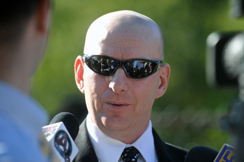 Gilberton Police Chief Mark Kessler talks with reporters this week before a closed disciplinary hearing.