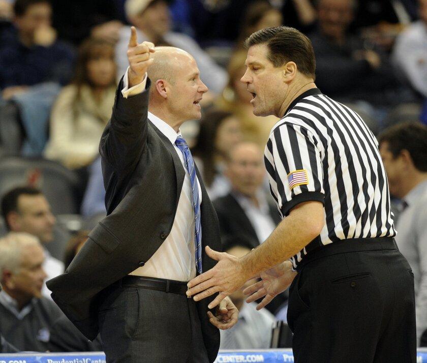Seton Hall head coach Kevin Willard, left, argues with a referee during an NCAA college basketball game against Villanova, Wednesday, Jan 8, 2014, in Newark, N.J. Villanova won 83-67. (AP Photo/Joe Epstein)