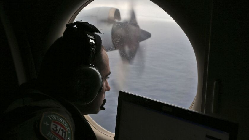 FILE - In this March 22, 2014, file photo, flight officer Rayan Gharazeddine scans the water in the