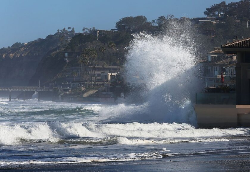 At La Jolla Shores Tuesday, waves slammed into houses at the north end of the boardwalk and poured over the seawall.