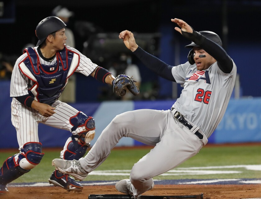 Ryutaro Umeno reaches out to tag Triston Casas at home plate.