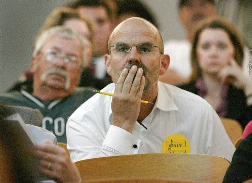 Davis Rouillard, a San Diego Unified School District music teacher, listens intently during the public comment period at the board meeting Tuesday morning.
