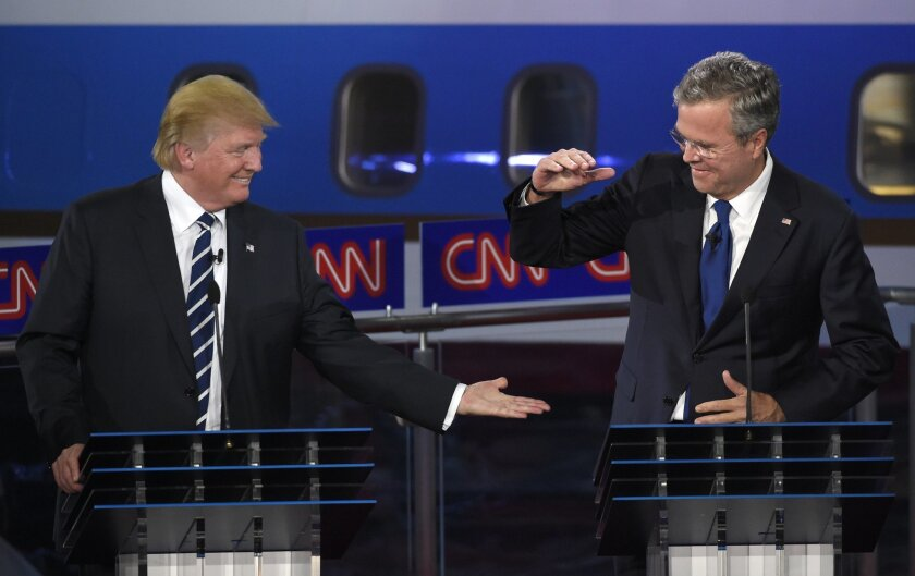 Republican presidential candidate, businessman Donald Trump, left, and Jeb Bush slap hands near the finish of the CNN Republican presidential debate at the Ronald Reagan Presidential Library and Museum on Wednesday, Sept. 16, 2015, in Simi Valley, Calif. (AP Photo/Mark J. Terrill)