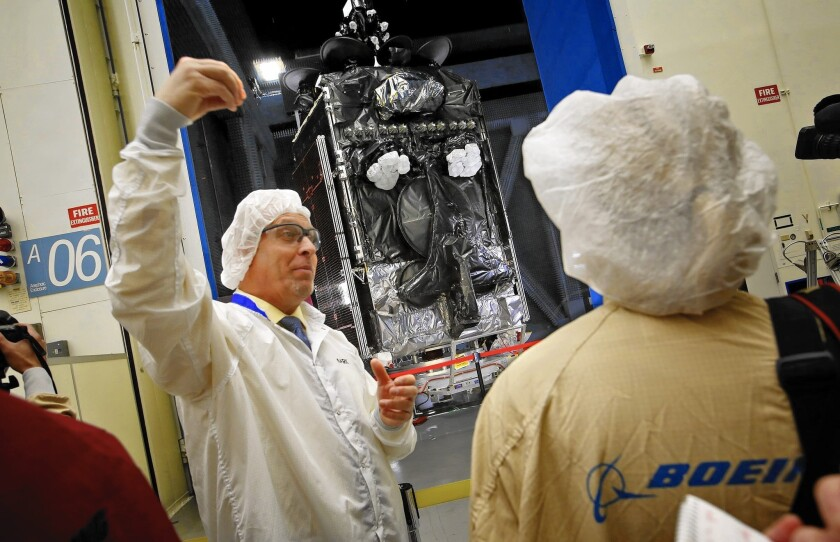Mark Spiwak, president of Boeing Satellite Systems International, talks about a new all-electric communications satellite at Boeing's satellite building facility in El Segundo in January.