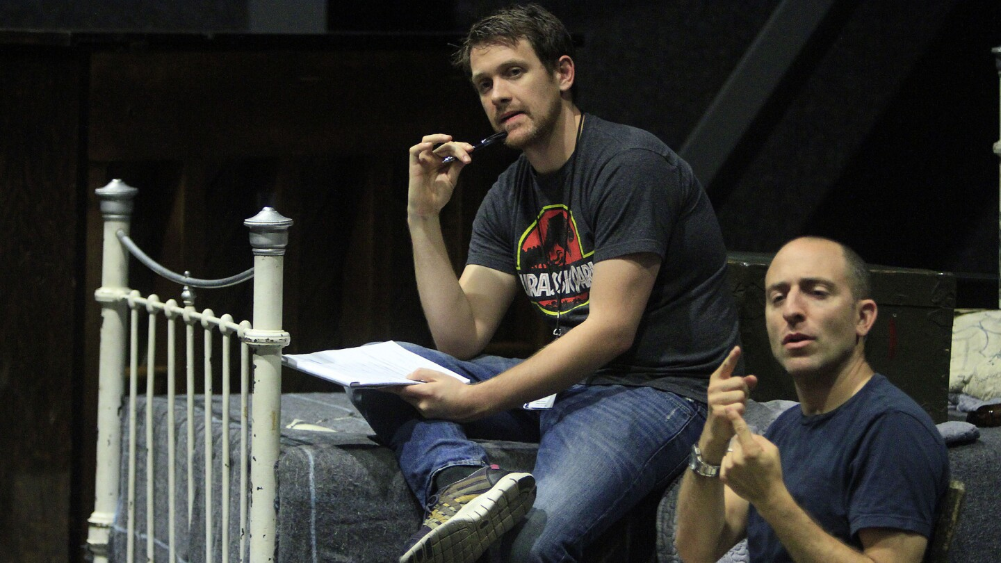 Director Michael Arden, left, and interpreter Alek Lev work with the cast during a rehearsal.
