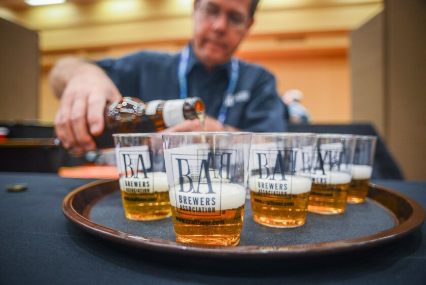 A steward pours beer before delivering to Great American Beer Festival judges.