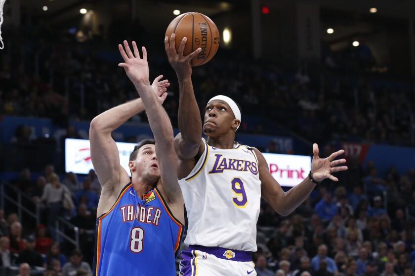 Lakers point guard Rajon Rondo attempts a layup against Thunder forward Danilo Gallinari in Oklahoma City.