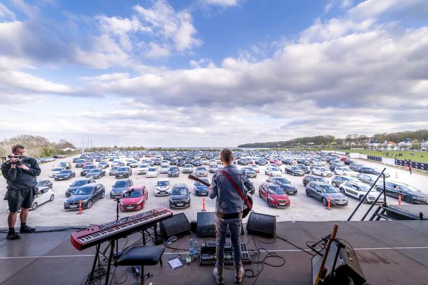 Singer-songwriter Mads Langer is shown performing a drive-in concert in Aarhus, Denmark, on April 24, 2020.
