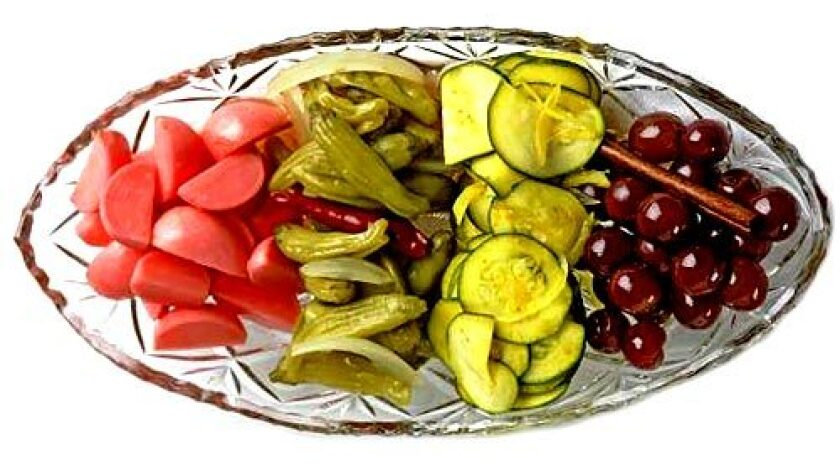SPICY BITES: The relish tray includes pickled radishes, peppers, zucchini and grapes.