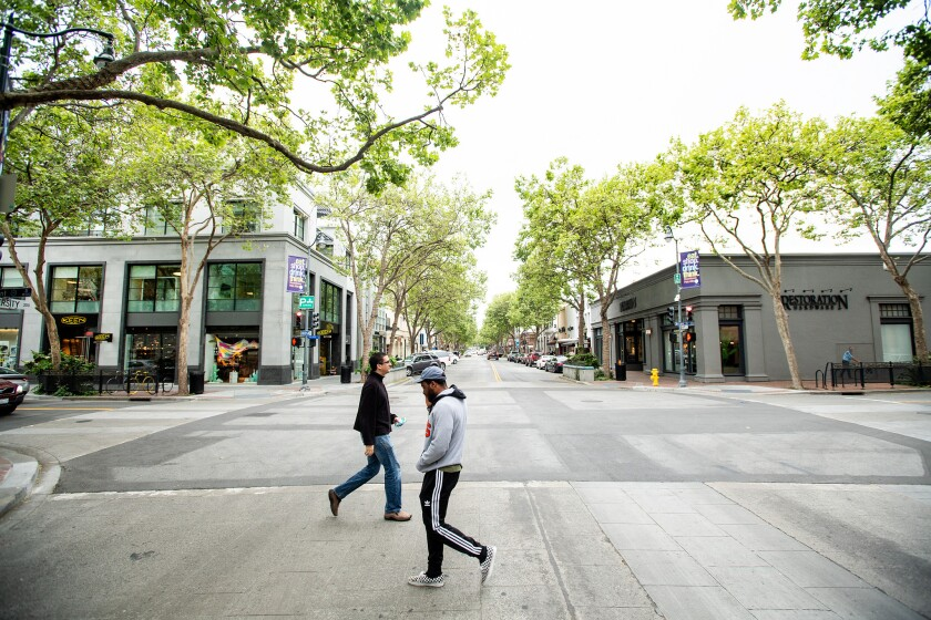 Pedestrians cross University Avenue in Palo Alto. Senate Bill 50 could clear the way for higher-density housing in the area.