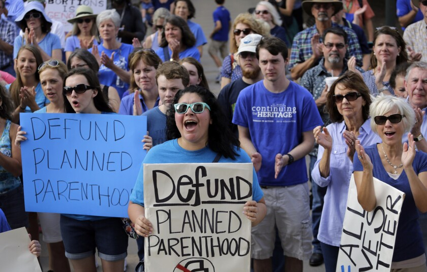 Antiabortion activists rally outside the Texas Capitol in Austin. A new study links the defunding of Planned Parenthood and other family planning clinics in the state with a rise in births among low-income women.