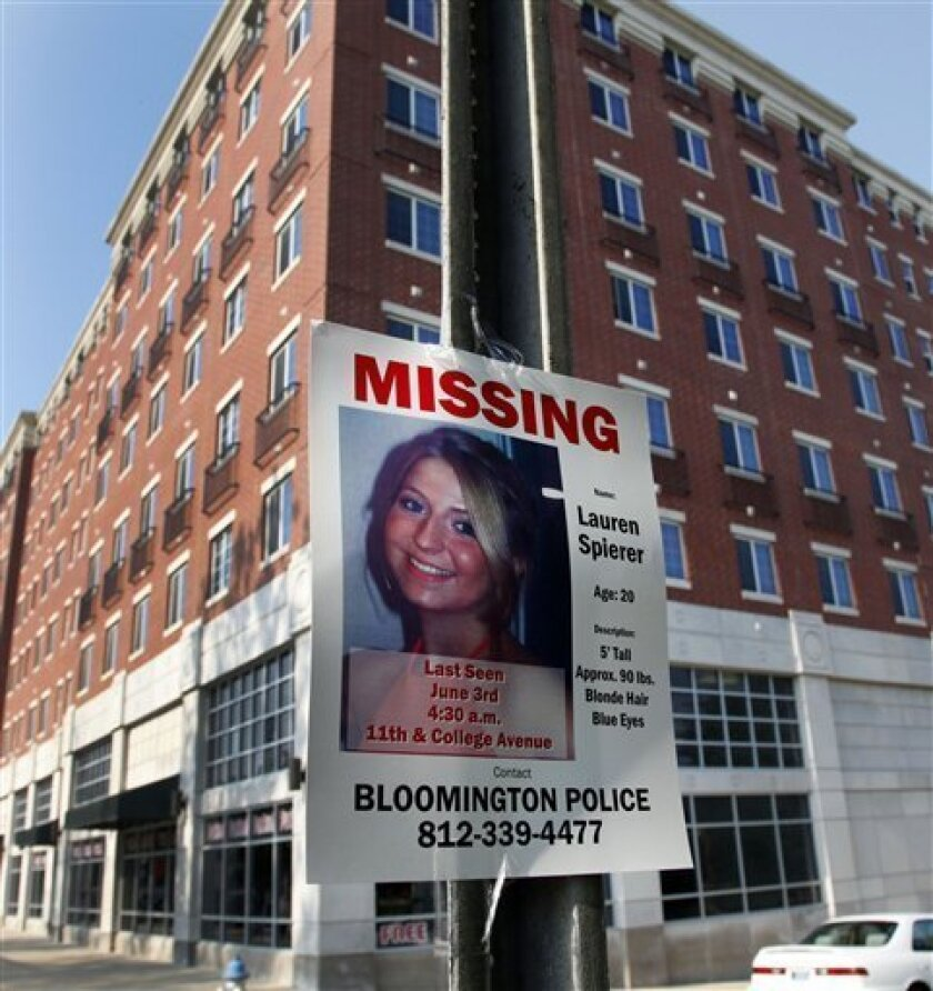 A missing person poster of Lauren Spierer, 20, is posted on a sign post outside her apartment building in Bloomington, Ind., Tuesday, June 7, 2011. Spierer disappeared around 4:20 a.m. on Friday. Police say they suspect foul play in the disappearance of a 20-year-old Indiana University student five days ago, but have little information about what happened to her. (AP Photo/Michael Conroy)