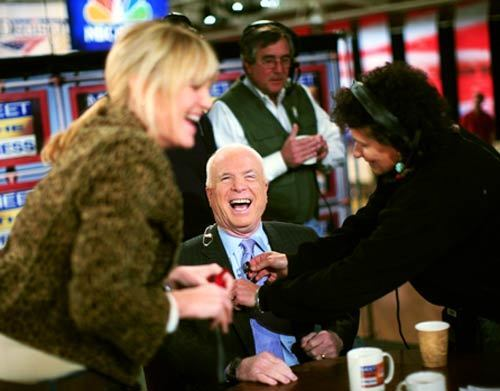 """Makeup artist Kriss Soterion, left, gets Sen. John McCain, R-Ariz., ready for an appearance on """"Meet the Press"""" earlier this month. Soterion's routine for preparing a male candidate begins with a camouflage concealer to cover any trouble spots, followed by a cream foundation. """"With men you're just matching skin tone — creating a blank canvas,"""" she says."""