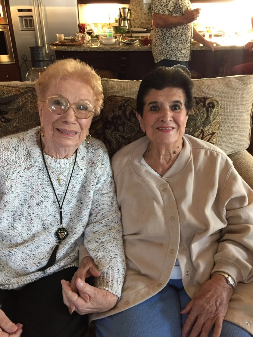 "Corrine ""Corky"" Casserly, 91, left, and her sister Ruth ""Ruthie"" Sorney, 95, hold hands in this photograph from 2018."