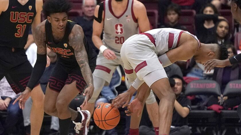 Southern California guard Kevin Porter Jr. (4) steals the ball from Stanford forward KZ Okpala (0) d