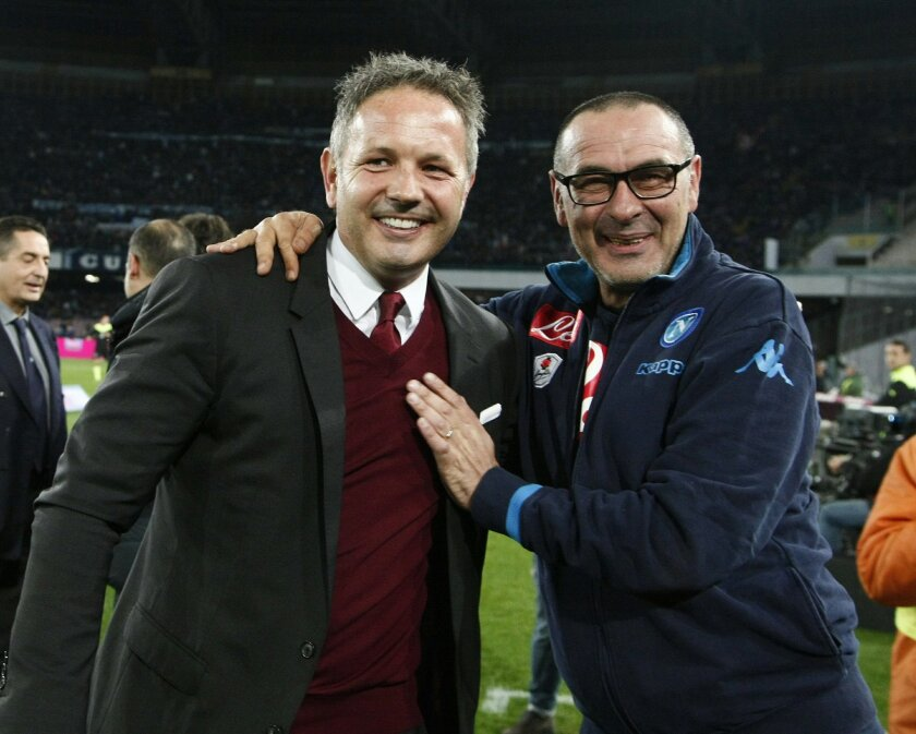 AC Milan coach Sinisa Mihajlovic, left, and Napoli coach Maurizio Sarri pose for photographers before a soccer match between Napoli and AC Milan at the San Paolo stadium in Naples, Italy, Monday, Feb. 22, 2016. (AP Photo/Salvatore Laporta)