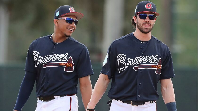 Atlanta Braves Dansby Swanson and Johan Camargo work the infield during baseball spring training on