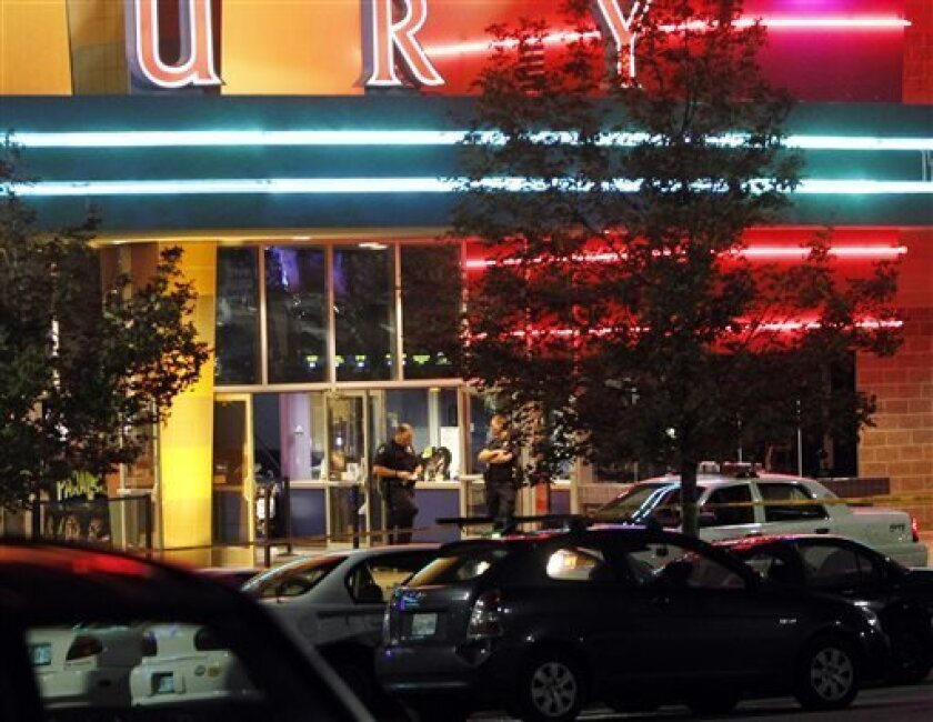 FILE This July 20, 2012 file photo shows police outside of a Century 16 movie theatre in Aurora, Colo. after a shooting during the showing of a movie. Police and fire officials failed to tell each other when and where rescuers were needed following the Aurora theater shootings, according to reports obtained by the Denver Post. (AP Photo/Ed Andrieski, File)