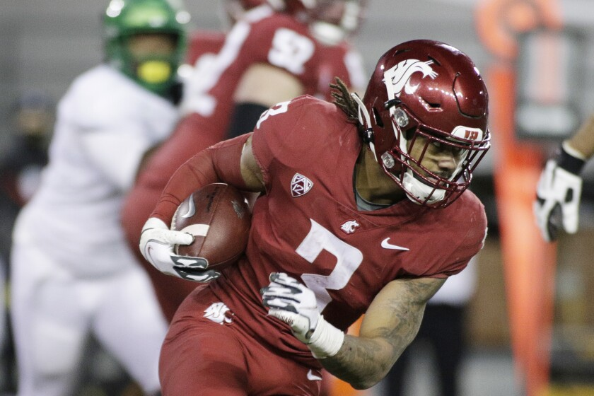 Washington State running back Deon McIntosh carries the ball against Oregon.