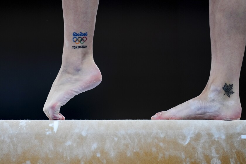 Shallon Olsen, of Canada, performs on the balance beam during the women's artistic gymnastic qualifications at the 2020 Summer Olympics, Sunday, July 25, 2021, in Tokyo. (AP Photo/Natacha Pisarenko)