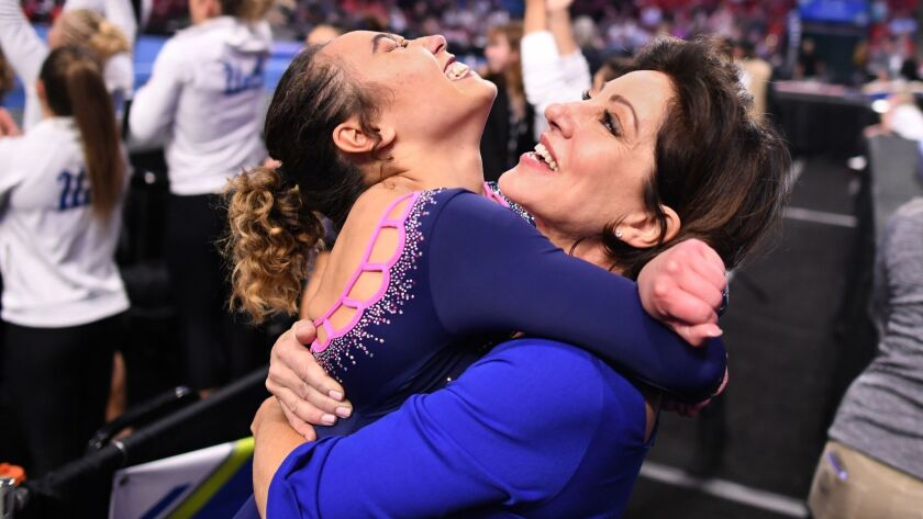 SALT LAKE CITY, UTAH MARCH 23, 2019-Katelyn Ohashi jumps into the arms of coach Valorie Konfros afte