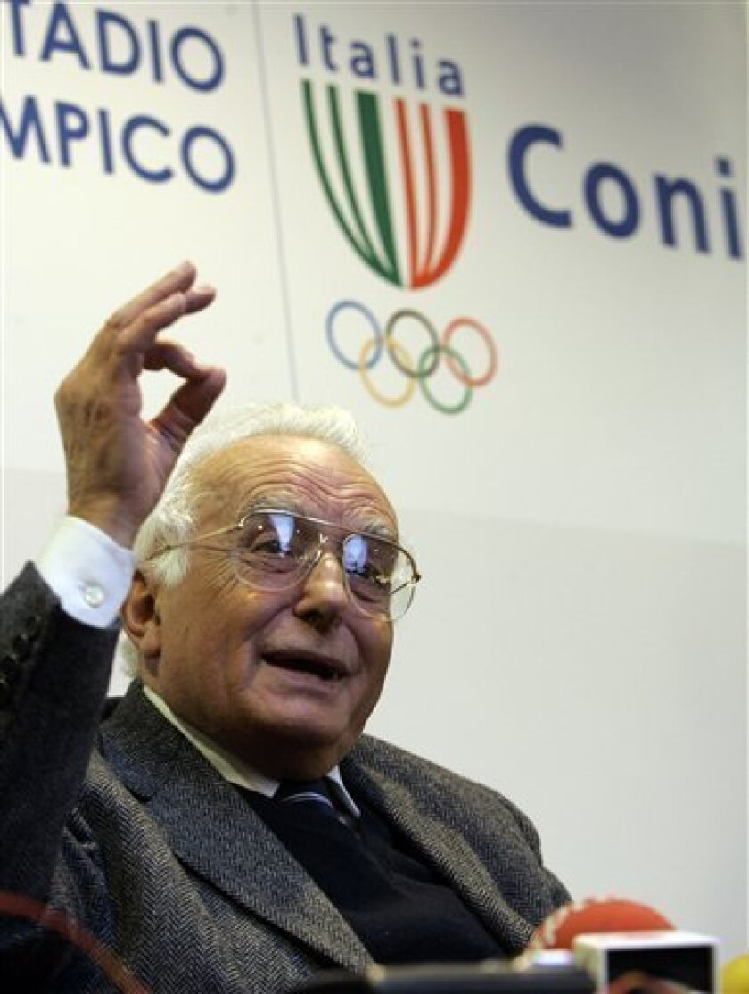 """FILE - In this Feb. 19, 2009 file photo, Italian Olympic Committee's anti-doping prosecutor Ettore Torri gestures during a press conference at the Olympic Committee's headquarters at Rome's Olympic stadium. After four years as the Italian Olympic Committee's anti-doping prosecutor, Torri is convinced that all pro cyclists are doping. In his first interview in two years, he told The Associated Press it's not just a personal hunch anymore: """"I'm not the only one saying it. Lately, all of the cyclists I've interrogated have said that everyone dopes."""" (AP Photo/Pier Paolo Cito, File)"""