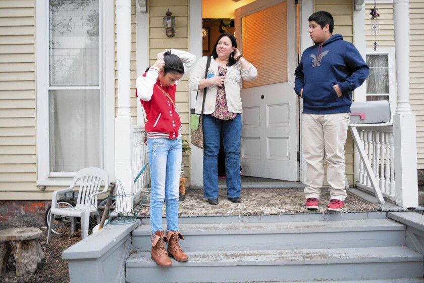 Activist Veronica Isabel Dahlberg talks with Diona, 12, and Cristian Ramos, 14, whose father was in immigration detention and close to being deported in March, when Dahlberg helped keep him in the country.