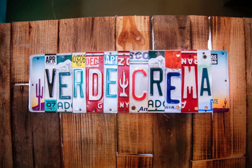 Verde y Crema Restaurant off to the side of Boulevard Agua Caliente. Organic dining and creative dishes. Logo made from license plates. (Alejandro Tamayo/ Union Tribune)