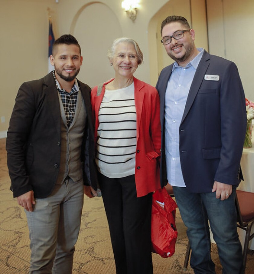 Edgar Uribe (left) with Piatti customer Martha Ehringer and Jesse Vigil of Big Table.