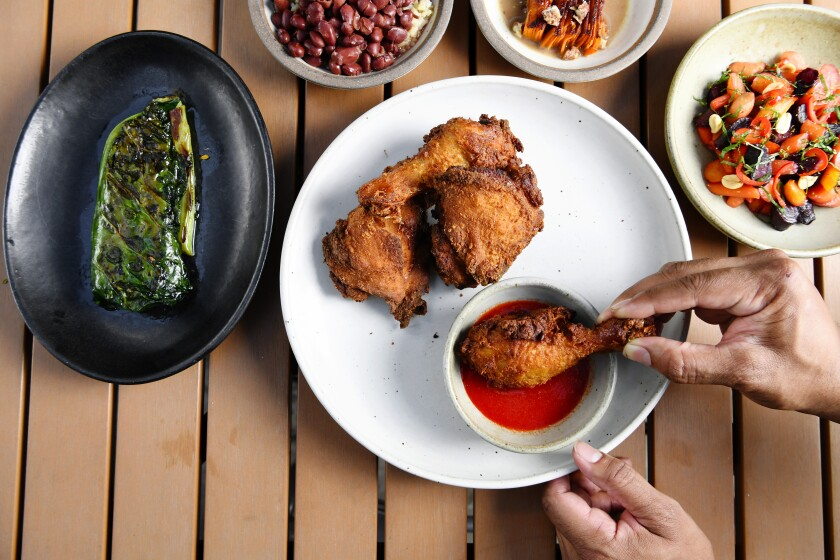Fried chicken with collards and other side dishes at Alta Adams