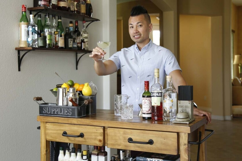 Efren Agustin's enthusiasm for mixing spirits has evolved into a fully loaded bar cart that rivals many establishments that serve alcohol.