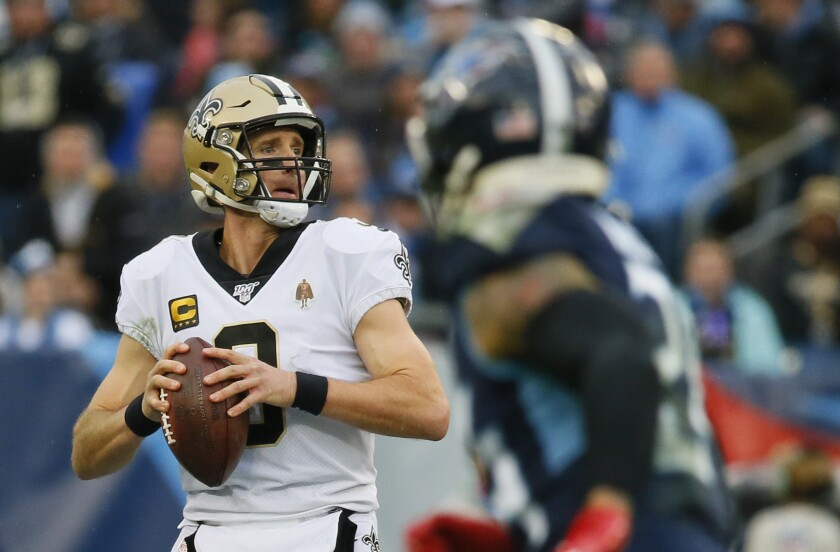 New Orleans Saints quarterback Drew Brees looks to pass against the Tennessee Titans on Sunday.
