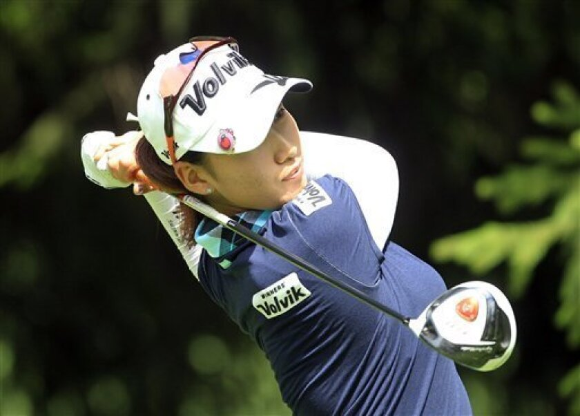 Chella Choi hits from the tee box on the 13th hole during the second round of the Jamie Farr Toledo Classic golf tournament at the Highland Meadows Golf Club in Sylvania, Ohio, Friday, Aug. 10, 2012. (AP Photo/Carlos Osorio)