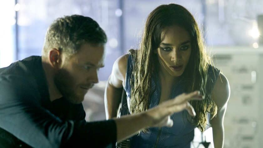 "Aaron Ashmore and Hannah John-Kamen in ""Killjoys"" on Syfy."