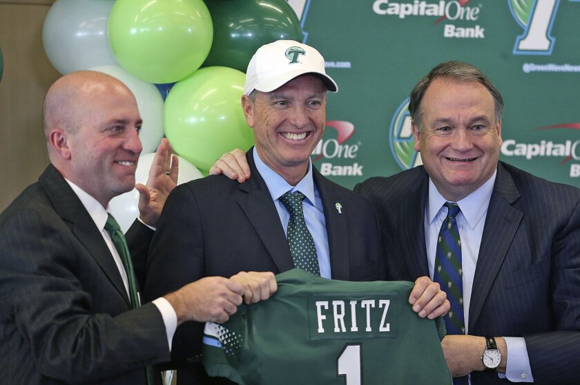 Athletic director Troy Dannen, left, and Tulane president Michael A. Fitts, right, pose with Willie Fritz after he is formally introduced as Tulane's head football coach during a news conference at Yulman Stadium at Tulane University in New Orleans on Tuesday, Dec. 15, 2015. (Michael DeMocker/NOLA.