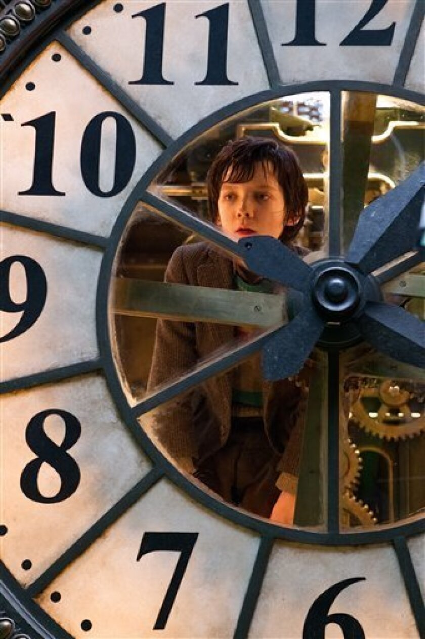 "In this image released by Paramount Pictures, Asa Butterfield portrays Hugo Cabret in a scene from ""Hugo.""  The film, adapted from Brian Selznick's award-winning illustrated book ""The Invention of Hugo Cabret,"" is about a 12-year-old orphan who lives in a 1930 Paris train station.  (AP Photo/Paramo"