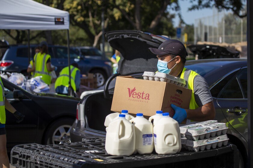 A monthly drive-thru food distribution at Mile Square Park on Wednesday, Oct. 14, 2020 in Fountain Valley, CA.