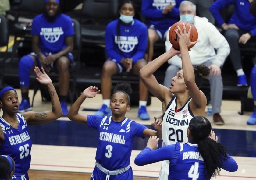 Connecticut forward Olivia Nelson-Ododa (20) shoots between Seton Hall defenders Lauren Park-Lane (3) and Andra Espinoza-Hunter during the first half of an NCAA college basketball game Wednesday, Feb. 10, 2021, in Storrs, Conn. (David Butler II/Pool Photo via AP)