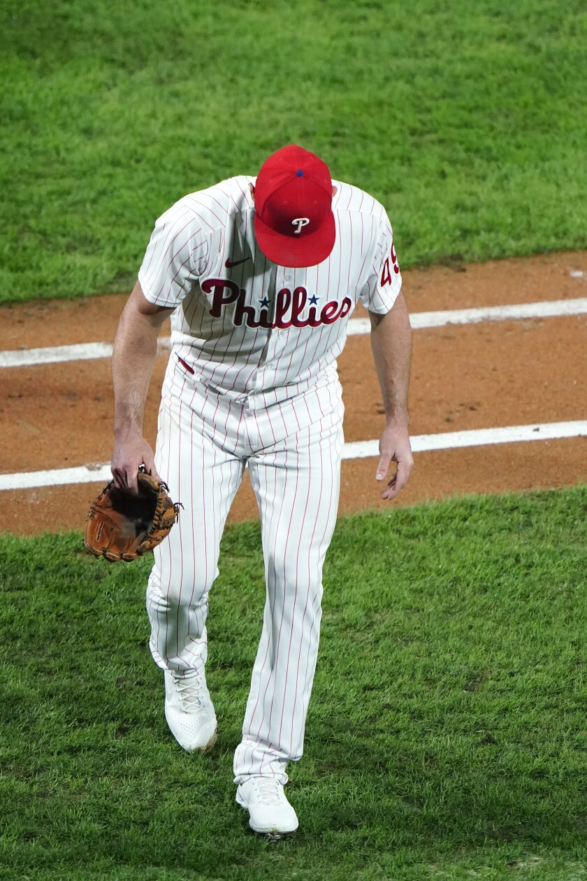 Philadelphia Phillies pitcher Jake Arrieta walks to the dugout after an injury during the sixth inning of a baseball game against the New York Mets, Tuesday, Sept. 15, 2020, in Philadelphia. (AP Photo/Matt Slocum)
