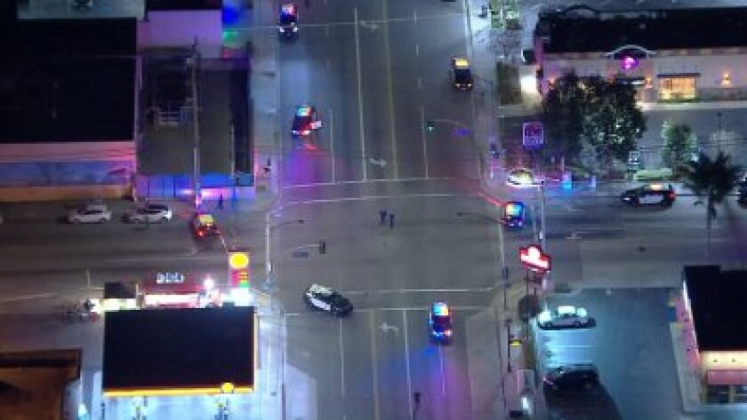Police close Atlantic Avenue and Market Street in Long Beach on Thursday night after a shooting.