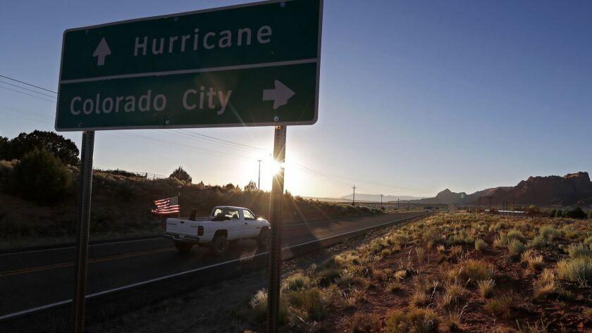 COLORADO CITY, AZ. - JUNE 22, 2018. A motorist drives down State Route 59 in Colorado City, Ariz.,