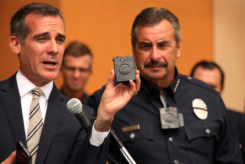 Los Angeles Mayor Eric Garcetti, left, and LAPD Chief Charlie Beck show off the police department's new body camera. Beck is wearing one of the devices.